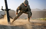Pfc. Josh Barrios, a mortarman from Torrence, Calif., working with B Troop, 1st Squadron, 40th Cavalry Regiment, 4th Brigade Combat Team (Airborne), 25th Infantry Division, lunges to a safe distance after firing a mortar during a mission Dec. 16 at Camp Clark in the Khost Province of eastern Afghanistan. (Photo by US Army Pfc. Andrya Hill)
