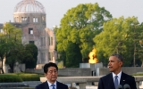 President Barack Obama, flanked by Japanese Prime Minister Shinzo Abe, delivers a speech as the atomic bomb dome is seen in the background. REUTERS/Carlos Barria