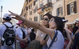 Two japanese tourists visiting in Piazza Spagna Rome, Italy